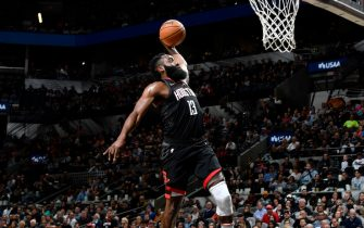 SAN ANTONIO, TX - DECEMBER 3: James Harden #13 of the Houston Rockets dunks the ball against the San Antonio Spurs on December 3, 2019 at the AT&T Center in San Antonio, Texas. NOTE TO USER: User expressly acknowledges and agrees that, by downloading and or using this photograph, user is consenting to the terms and conditions of the Getty Images License Agreement. Mandatory Copyright Notice: Copyright 2019 NBAE (Photos by Logan Riely/NBAE via Getty Images)