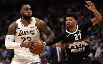 DENVER, COLORADO - DECEMBER 03: Lebron James #23 of the Los Angeles Lakers drives against Jamal Murray #27 of the Denver Nuggets in the first quarter at Pepsi Center on December 03, 2019 in Denver, Colorado. NOTE TO USER: User expressly acknowledges and agrees that, by downloading and or using this photograph, User is consenting to the terms and conditions of the Getty Images License Agreement. (Photo by Matthew Stockman/Getty Images)