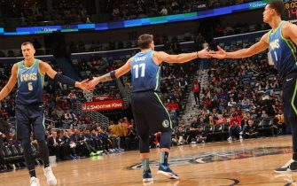 NEW ORLEANS, LA - DECEMBER 3: Kristaps Porzingis #6, Luka Doncic #77, and Courtney Lee #1 of the Dallas Mavericks hi-five during a game against the New Orleans Pelicans on December 3, 2019 at the Smoothie King Center in New Orleans, Louisiana. NOTE TO USER: User expressly acknowledges and agrees that, by downloading and or using this Photograph, user is consenting to the terms and conditions of the Getty Images License Agreement. Mandatory Copyright Notice: Copyright 2019 NBAE (Photo by Layne Murdoch Jr./NBAE via Getty Images)