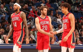 NEW ORLEANS, LA - DECEMBER 3: Nicolo Melli #20 and Jaxson Hayes #10 of the New Orleans Pelicans hi-five during a game against the Dallas Mavericks on December 3, 2019 at the Smoothie King Center in New Orleans, Louisiana. NOTE TO USER: User expressly acknowledges and agrees that, by downloading and or using this Photograph, user is consenting to the terms and conditions of the Getty Images License Agreement. Mandatory Copyright Notice: Copyright 2019 NBAE (Photo by Layne Murdoch Jr./NBAE via Getty Images)