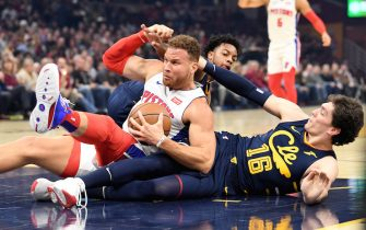 CLEVELAND, OHIO - DECEMBER 03: Blake Griffin #23 of the Detroit Pistons fights for a loos ball with Cedi Osman #16 and Darius Garland #10 of the Cleveland Cavaliers during the first half at Rocket Mortgage Fieldhouse on December 03, 2019 in Cleveland, Ohio. NOTE TO USER: User expressly acknowledges and agrees that, by downloading and/or using this photograph, user is consenting to the terms and conditions of the Getty Images License Agreement. (Photo by Jason Miller/Getty Images)