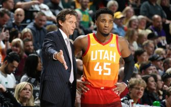 SALT LAKE CITY, UT - DECEMBER 4: Head Coach, Quin Snyder shares a conversation with his player, Donovan Mitchell #45 during the game against the Los Angeles Lakers on December 4, 2019 at vivint.SmartHome Arena in Salt Lake City, Utah. NOTE TO USER: User expressly acknowledges and agrees that, by downloading and or using this Photograph, User is consenting to the terms and conditions of the Getty Images License Agreement. Mandatory Copyright Notice: Copyright 2019 NBAE (Photo by Melissa Majchrzak/NBAE via Getty Images)