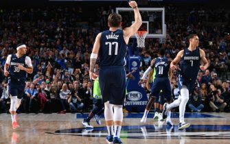 DALLAS, TX - DECEMBER 4: Luka Doncic #77 of the Dallas Mavericks reacts to a play against the Minnesota Timberwolves on December 04, 2019 at the American Airlines Center in Dallas, Texas. NOTE TO USER: User expressly acknowledges and agrees that, by downloading and or using this photograph, User is consenting to the terms and conditions of the Getty Images License Agreement. Mandatory Copyright Notice: Copyright 2019 NBAE (Photo by Glenn James/NBAE via Getty Images)