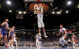 ORLANDO, FL - DECEMBER 4: Aaron Gordon #00 of the Orlando Magic dunks the ball against the Phoenix Suns on December 4, 2019 at Amway Center in Orlando, Florida. NOTE TO USER: User expressly acknowledges and agrees that, by downloading and or using this photograph, User is consenting to the terms and conditions of the Getty Images License Agreement. Mandatory Copyright Notice: Copyright 2019 NBAE (Photo by Fernando Medina/NBAE via Getty Images)