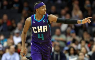 CHARLOTTE, NORTH CAROLINA - DECEMBER 04: Devonte' Graham #4 of the Charlotte Hornets reacts after a play against the Golden State Warriors during their game at Spectrum Center on December 04, 2019 in Charlotte, North Carolina. NOTE TO USER: User expressly acknowledges and agrees that, by downloading and or using this photograph, User is consenting to the terms and conditions of the Getty Images License Agreement. (Photo by Streeter Lecka/Getty Images)
