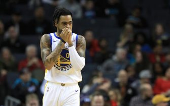 CHARLOTTE, NORTH CAROLINA - DECEMBER 04: D'Angelo Russell #0 of the Golden State Warriors watches on against the Charlotte Hornets during their game at Spectrum Center on December 04, 2019 in Charlotte, North Carolina. NOTE TO USER: User expressly acknowledges and agrees that, by downloading and or using this photograph, User is consenting to the terms and conditions of the Getty Images License Agreement. (Photo by Streeter Lecka/Getty Images)