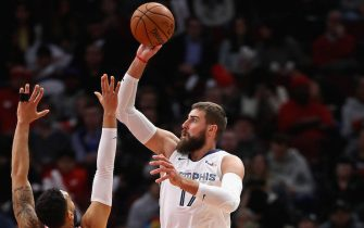 CHICAGO, ILLINOIS - DECEMBER 04: Jonas Valanciunas #17 of the Memphis Grizzlies shoots between Denzel Valentine #45 and Daniel Gafford #12 of the Chicago Bulls at the United Center on December 04, 2019 in Chicago, Illinois. NOTE TO USER: User expressly acknowledges and agrees that , by downloading and or using this photograph, User is consenting to the terms and conditions of the Getty Images License Agreement. (Photo by Jonathan Daniel/Getty Images)