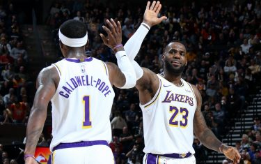 SALT LAKE CITY, UT - DECEMBER 4: Kentavious Caldwell-Pope #1 of the Los Angeles Lakers high fives teammate LeBron James #23 during the game against the Utah Jazz on December 4, 2019 at vivint.SmartHome Arena in Salt Lake City, Utah. NOTE TO USER: User expressly acknowledges and agrees that, by downloading and or using this Photograph, User is consenting to the terms and conditions of the Getty Images License Agreement. Mandatory Copyright Notice: Copyright 2019 NBAE (Photo by Melissa Majchrzak/NBAE via Getty Images)