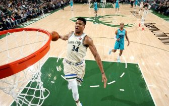 MILWAUKEE, WI - NOVEMBER 30: Giannis Antetokounmpo #34 of the Milwaukee Bucks dunks the ball during a game against the Charlotte Hornets on November 30, 2019 at the Fiserv Forum Center in Milwaukee, Wisconsin. NOTE TO USER: User expressly acknowledges and agrees that, by downloading and or using this Photograph, user is consenting to the terms and conditions of the Getty Images License Agreement. Mandatory Copyright Notice: Copyright 2019 NBAE (Photo by Gary Dineen/NBAE via Getty Images).
