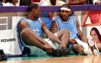 """LOS ANGELES - JULY 27: LeBron James and Carmelo Anthony chat while waiting to check into the game during Magic Johnson's18th annual """"A Midsummer Night's Magic"""" charity game at Staples Center on July 27, 2003 in Los Angeles, California.  NOTE TO USER: User expressly acknowledges and agrees that, by downloading and/or using this Photograph, User is consenting to the terms and conditions of the Getty Images License Agreement. (Photo by Andrew D. Bernstein/NBAE via Getty Images)"""