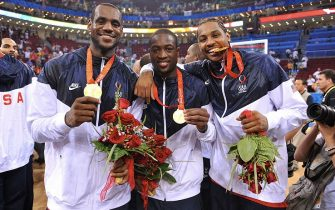 BEIJING - AUGUST 24: (L-R) LeBron James #6, Dwyane Wade #9 and Carmelo Anthony #15 of the U.S. Men's Senior National Team celebrates winning the men's gold medal basketball game at the 2008 Beijing Olympic Games at the Beijing Olympic Basketball gymnasium on August 24, 2008 in Beijing, China. The United States defeated Spain 118-107 to take the Men's Basketball gold medal. NOTE TO USER: User expressly acknowledges and agrees that, by downloading and/or using this Photograph, user is consenting to the terms and conditions of the Getty Images License Agreement. Mandatory Copyright Notice: Copyright 2008 NBAE (Photo by Jesse Garrabrant/NBAE via Getty Images)