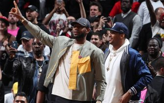 BROOKLYN, NY - APRIL 10: LeBron James #23 of the Los Angeles Lakers and Carmelo Anthony react during the game between the Miami Heat and Brooklyn Nets on April 10, 2019 at Barclays Center in Brooklyn, New York. NOTE TO USER: User expressly acknowledges and agrees that, by downloading and or using this Photograph, user is consenting to the terms and conditions of the Getty Images License Agreement. Mandatory Copyright Notice: Copyright 2019 NBAE (Photo by Nathaniel S. Butler/NBAE via Getty Images)