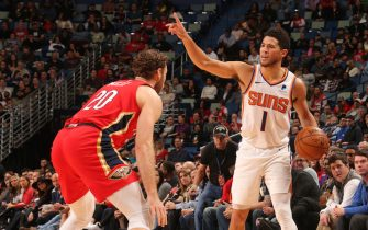 NEW ORLEANS, LA - DECEMBER 5: Devin Booker #1 of the Phoenix Suns handles the ball against the New Orleans Pelicans on December 5, 2019 at the Smoothie King Center in New Orleans, Louisiana. NOTE TO USER: User expressly acknowledges and agrees that, by downloading and or using this Photograph, user is consenting to the terms and conditions of the Getty Images License Agreement. Mandatory Copyright Notice: Copyright 2019 NBAE (Photo by Layne Murdoch Jr./NBAE via Getty Images)