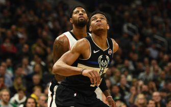 MILWAUKEE, WISCONSIN - DECEMBER 06:  Giannis Antetokounmpo #34 of the Milwaukee Bucks works against Paul George #13 of the Los Angeles Clippers during the second half of a game at Fiserv Forum on December 06, 2019 in Milwaukee, Wisconsin. NOTE TO USER: User expressly acknowledges and agrees that, by downloading and or using this photograph, User is consenting to the terms and conditions of the Getty Images License Agreement.  (Photo by Stacy Revere/Getty Images)
