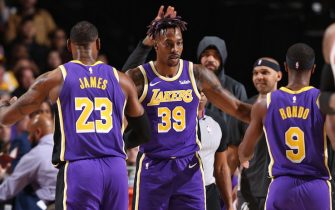 PORTLAND, OR - DECEMBER 6: Dwight Howard #39 of the Los Angeles Lakers high-fives his teammates during a game against the Portland Trail Blazers on December 6, 2019 at the Moda Center Arena in Portland, Oregon. NOTE TO USER: User expressly acknowledges and agrees that, by downloading and or using this photograph, user is consenting to the terms and conditions of the Getty Images License Agreement. Mandatory Copyright Notice: Copyright 2019 NBAE (Photo by Sam Forencich/NBAE via Getty Images)