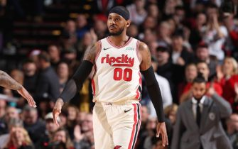 PORTLAND, OR - DECEMBER 6: Carmelo Anthony #00 of the Portland Trail Blazers looks on during a game against the Los Angeles Lakers on December 6, 2019 at the Moda Center Arena in Portland, Oregon. NOTE TO USER: User expressly acknowledges and agrees that, by downloading and or using this photograph, user is consenting to the terms and conditions of the Getty Images License Agreement. Mandatory Copyright Notice: Copyright 2019 NBAE (Photo by Sam Forencich/NBAE via Getty Images)