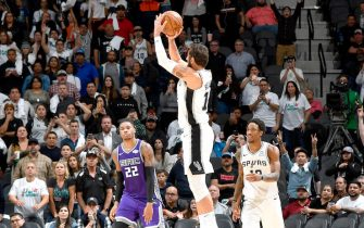 SAN ANTONIO, TX - DECEMBER 6: Marco Belinelli #18 of the San Antonio Spurs shoots the shot to send the game into overtime against the Sacramento Kings on December 6, 2019 at the AT&T Center in San Antonio, Texas. NOTE TO USER: User expressly acknowledges and agrees that, by downloading and or using this photograph, user is consenting to the terms and conditions of the Getty Images License Agreement. Mandatory Copyright Notice: Copyright 2019 NBAE (Photos by Logan Riely/NBAE via Getty Images)