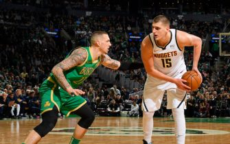 BOSTON, MA - DECEMBER 6: Nikola Jokic #15 of the Denver Nuggets handles the ball against the Boston Celtics on December 6, 2019 at the TD Garden in Boston, Massachusetts.  NOTE TO USER: User expressly acknowledges and agrees that, by downloading and or using this photograph, User is consenting to the terms and conditions of the Getty Images License Agreement. Mandatory Copyright Notice: Copyright 2019 NBAE  (Photo by Brian Babineau/NBAE via Getty Images)