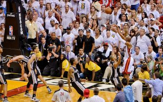 MIAMI, FL - JUNE 18: Ray Allen #34 of the Miami Heat makes a game-tying three-pointer in the fourth quarter to force overtime against the San Antonio Spurs during Game Six of the 2013 NBA Finals on June 18, 2013 at American Airlines Arena in Miami, Florida. NOTE TO USER: User expressly acknowledges and agrees that, by downloading and or using this photograph, User is consenting to the terms and conditions of the Getty Images License Agreement. Mandatory Copyright Notice: Copyright 2013 NBAE (Photo by Noah Graham/NBAE via Getty Images)