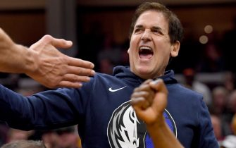 CLEVELAND, OHIO - NOVEMBER 03: Mark Cuban owner of the Dallas Mavericks celebrates with his team from the bench during the first half against the Cleveland Cavaliers at Rocket Mortgage Fieldhouse on November 03, 2019 in Cleveland, Ohio. NOTE TO USER: User expressly acknowledges and agrees that, by downloading and/or using this photograph, user is consenting to the terms and conditions of the Getty Images License Agreement. (Photo by Jason Miller/Getty Images)