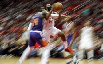 HOUSTON, TX - DECEMBER 07:  James Harden #13 of the Houston Rockets drives to the basket defended by Cheick Diallo #14 of the Phoenix Suns in the second half at Toyota Center on December 7, 2019 in Houston, Texas.  NOTE TO USER: User expressly acknowledges and agrees that, by downloading and or using this photograph, User is consenting to the terms and conditions of the Getty Images License Agreement.  (Photo by Tim Warner/Getty Images)