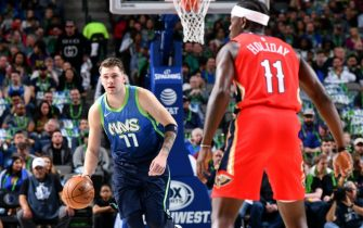 DALLAS, TX - DECEMBER 7: Luka Doncic #77 of the Dallas Mavericks handles the ball against the New Orleans Pelicans on December 07, 2019 at the American Airlines Center in Dallas, Texas. NOTE TO USER: User expressly acknowledges and agrees that, by downloading and or using this photograph, User is consenting to the terms and conditions of the Getty Images License Agreement. Mandatory Copyright Notice: Copyright 2019 NBAE (Photo by Glenn James/NBAE via Getty Images)