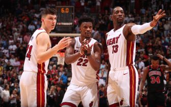 MIAMI, FL - DECEMBER 8: Tyler Herro #14 of the Miami Heat, Jimmy Butler #22 of the Miami Heat, and Bam Adebayo #13 of the Miami Heat look on during a game against the Chicago Bulls on December 8, 2019 at American Airlines Arena in Miami, Florida. NOTE TO USER: User expressly acknowledges and agrees that, by downloading and or using this Photograph, user is consenting to the terms and conditions of the Getty Images License Agreement. Mandatory Copyright Notice: Copyright 2019 NBAE (Photo by Issac Baldizon/NBAE via Getty Images)