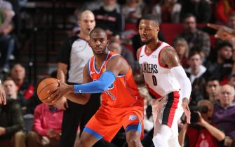 PORTLAND, OR - DECEMBER 8: Chris Paul #3 of the Oklahoma City Thunder handles the ball against Damian Lillard #0 of the Portland Trail Blazers on December 8, 2019 at the Moda Center Arena in Portland, Oregon. NOTE TO USER: User expressly acknowledges and agrees that, by downloading and or using this photograph, user is consenting to the terms and conditions of the Getty Images License Agreement. Mandatory Copyright Notice: Copyright 2019 NBAE (Photo by Sam Forencich/NBAE via Getty Images)