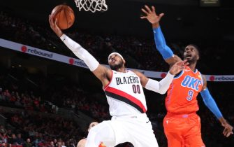 PORTLAND, OR - DECEMBER 8: Carmelo Anthony #00 of the Portland Trail Blazers shoots the ball against the Oklahoma City Thunder on December 8, 2019 at the Moda Center Arena in Portland, Oregon. NOTE TO USER: User expressly acknowledges and agrees that, by downloading and or using this photograph, user is consenting to the terms and conditions of the Getty Images License Agreement. Mandatory Copyright Notice: Copyright 2019 NBAE (Photo by Sam Forencich/NBAE via Getty Images)