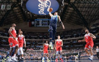 DALLAS, TX - DECEMBER 8: Luka Doncic #77 of the Dallas Mavericks dunks the ball against the Sacramento Kings on December 8, 2019 at the American Airlines Center in Dallas, Texas. NOTE TO USER: User expressly acknowledges and agrees that, by downloading and or using this photograph, User is consenting to the terms and conditions of the Getty Images License Agreement. Mandatory Copyright Notice: Copyright 2019 NBAE (Photo by Glenn James/NBAE via Getty Images)