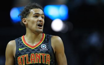 CHARLOTTE, NORTH CAROLINA - DECEMBER 08: Trae Young #11 of the Atlanta Hawks reacts after a play against the Charlotte Hornets during their game at Spectrum Center on December 08, 2019 in Charlotte, North Carolina. NOTE TO USER: User expressly acknowledges and agrees that, by downloading and or using this photograph, User is consenting to the terms and conditions of the Getty Images License Agreement. (Photo by Streeter Lecka/Getty Images)