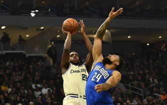 MILWAUKEE, WISCONSIN - DECEMBER 09:  Khris Middleton #22 of the Milwaukee Bucks shoots over Khem Birch #24 of the Orlando Magic during the first half of a game at Fiserv Forum on December 09, 2019 in Milwaukee, Wisconsin. NOTE TO USER: User expressly acknowledges and agrees that, by downloading and or using this photograph, User is consenting to the terms and conditions of the Getty Images License Agreement. (Photo by Stacy Revere/Getty Images)