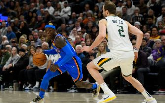 SALT LAKE CITY, UT - DECEMBER 09: Dennis Schroder #17 of the Oklahoma City Thunder drives around Joe Ingles #2 of the Utah Jazz during a game at Vivint Smart Home Arena on December 9, 2019 in Salt Lake City, Utah. NOTE TO USER: User expressly acknowledges and agrees that, by downloading and/or using this photograph, user is consenting to the terms and conditions of the Getty Images License Agreement.  (Photo by Alex Goodlett/Getty Images)