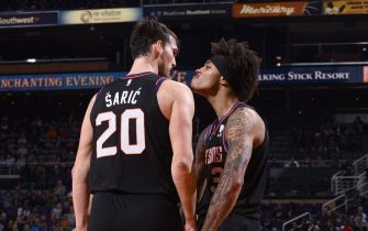PHOENIX, AZ - DECEMBER 9: Dario Saric #20, and Kelly Oubre Jr. #3 of the Phoenix Suns react to a play against the Minnesota Timberwolves on December 09, 2019 at Talking Stick Resort Arena in Phoenix, Arizona. NOTE TO USER: User expressly acknowledges and agrees that, by downloading and or using this photograph, user is consenting to the terms and conditions of the Getty Images License Agreement. Mandatory Copyright Notice: Copyright 2019 NBAE (Photo by Michael Gonzales/NBAE via Getty Images)