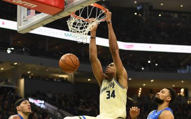 MILWAUKEE, WISCONSIN - DECEMBER 09:  Giannis Antetokounmpo #34 of the Milwaukee Bucks dunks during the first half of a game against the Orlando Magic at Fiserv Forum on December 09, 2019 in Milwaukee, Wisconsin. NOTE TO USER: User expressly acknowledges and agrees that, by downloading and or using this photograph, User is consenting to the terms and conditions of the Getty Images License Agreement. (Photo by Stacy Revere/Getty Images)
