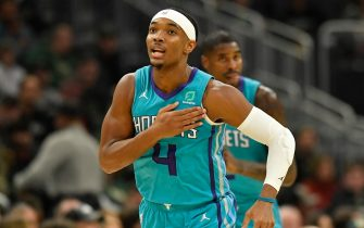MILWAUKEE, WISCONSIN - NOVEMBER 30: Devonte' Graham #4 of the Charlotte Hornets reacts after making a three pointer against the Milwaukee Bucks at Fiserv Forum on November 30, 2019 in Milwaukee, Wisconsin.  NOTE TO USER: User expressly acknowledges and agrees that, by downloading and or using this photograph, User is consenting to the terms and conditions of the Getty Images License Agreement.    (Photo by Quinn Harris/Getty Images)