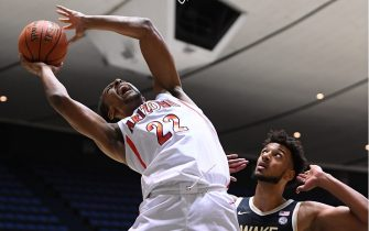 ANAHEIM, CA - DECEMBER 01:   Olivier Sarr #30 of the Wake Forest Demon Deacons avoids a foul on Zeke Nnaji #22 of the Arizona Wildcats as he goes for a basket in the first half of the game during the Wooden Legacy at the Anaheim Convention Center at on December 1, 2019 in Anaheim, California. (Photo by Jayne Kamin-Oncea/Getty Images)
