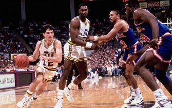 SALT LAKE CITY - 1989:  John Stockton #12 of the Utah Jazz drives to the basket around a Karl Malone #32 pick against the New York Knicks circa 1989 at the Delta Center in Salt Lake City, Utah. NOTE TO USER: User expressly acknowledges and agrees that, by downloading and/or using this Photograph, user is consenting to the terms and conditions of the Getty Images License Agreement.  Mandatory Copyright Notice: Copyright 1989 NBAE (Photo by Andrew D. Bernstein/NBAE via Getty Images)