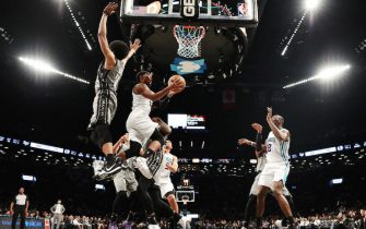NEW YORK, NEW YORK - DECEMBER 11: Devonte' Graham #4 of the Charlotte Hornets takes a shot past Jarrett Allen #31 of the Brooklyn Nets during the second half of their game at Barclays Center on December 11, 2019 in New York City. NOTE TO USER: User expressly acknowledges and agrees that, by downloading and or using this photograph, User is consenting to the terms and conditions of the Getty Images License Agreement.  (Photo by Emilee Chinn/Getty Images)