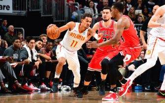 CHICAGO, IL - DECEMBER 11: Trae Young #11 of the Atlanta Hawks handles the ball during the game against the Chicago Bulls on December 11, 2019 at the United Center in Chicago, Illinois. NOTE TO USER: User expressly acknowledges and agrees that, by downloading and or using this photograph, user is consenting to the terms and conditions of the Getty Images License Agreement.  Mandatory Copyright Notice: Copyright 2019 NBAE (Photo by Scott Cunningham/NBAE via Getty Images)