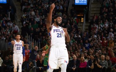 BOSTON, MA - DECEMBER 12: Joel Embiid #21 of the Philadelphia 76ers reacts to play against the Boston Celtics on December 12, 2019 at the TD Garden in Boston, Massachusetts.  NOTE TO USER: User expressly acknowledges and agrees that, by downloading and or using this photograph, User is consenting to the terms and conditions of the Getty Images License Agreement. Mandatory Copyright Notice: Copyright 2019 NBAE  (Photo by Brian Babineau/NBAE via Getty Images)