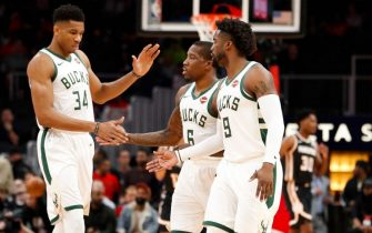 ATLANTA, GA - NOVEMBER 20: Giannis Antetokounmpo #34 of the Milwaukee Bucks reacts with teammates Eric Bledsoe #6 and Wesley Matthews #9 during the first half of an NBA game against the Atlanta Hawks at State Farm Arena on November 20, 2019 in Atlanta, Georgia. NOTE TO USER: User expressly acknowledges and agrees that, by downloading and/or using this Photograph, user is consenting to the terms and conditions of the Getty Images License Agreement. (Photo by Todd Kirkland/Getty Images)