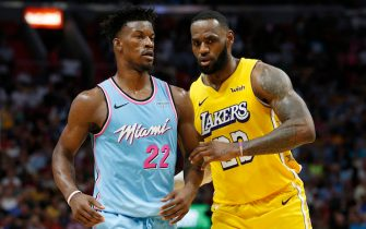 MIAMI, FLORIDA - DECEMBER 13:  LeBron James #23 of the Los Angeles Lakers guards Jimmy Butler #22 of the Miami Heat during the second half at American Airlines Arena on December 13, 2019 in Miami, Florida. NOTE TO USER: User expressly acknowledges and agrees that, by downloading and/or using this photograph, user is consenting to the terms and conditions of the Getty Images License Agreement (Photo by Michael Reaves/Getty Images)