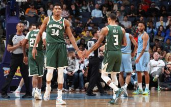 MEMPHIS, TN - DECEMBER 13: Giannis Antetokounmpo #34, and George Hill #3 hi-five each other against the Memphis Grizzlies on December 13, 2019 at FedExForum in Memphis, Tennessee. NOTE TO USER: User expressly acknowledges and agrees that, by downloading and or using this photograph, User is consenting to the terms and conditions of the Getty Images License Agreement. Mandatory Copyright Notice: Copyright 2019 NBAE (Photo by Joe Murphy/NBAE via Getty Images)