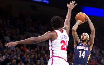 PHILADELPHIA, PA - DECEMBER 13: Brandon Ingram #14 of the New Orleans Pelicans shoots the ball against Joel Embiid #21 of the Philadelphia 76ers in the third quarter at the Wells Fargo Center on December 13, 2019 in Philadelphia, Pennsylvania. The 76ers defeated the Pelicans 116-109. NOTE TO USER: User expressly acknowledges and agrees that, by downloading and/or using this photograph, user is consenting to the terms and conditions of the Getty Images License Agreement. (Photo by Mitchell Leff/Getty Images)