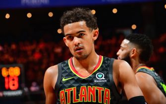 ATLANTA, GA - DECEMBER 13: Trae Young #11 of the Atlanta Hawks looks on during the game against the Indiana Pacers on December 13, 2019 at State Farm Arena in Atlanta, Georgia.  NOTE TO USER: User expressly acknowledges and agrees that, by downloading and/or using this Photograph, user is consenting to the terms and conditions of the Getty Images License Agreement. Mandatory Copyright Notice: Copyright 2019 NBAE (Photo by Scott Cunningham/NBAE via Getty Images)