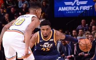 SALT LAKE CITY, UT - DECEMBER 13: Donovan Mitchell #45 of the Utah Jazz handles the ball against the Golden State Warriors on December 13, 2019 at vivint.SmartHome Arena in Salt Lake City, Utah. NOTE TO USER: User expressly acknowledges and agrees that, by downloading and or using this Photograph, User is consenting to the terms and conditions of the Getty Images License Agreement. Mandatory Copyright Notice: Copyright 2019 NBAE (Photo by Noah Graham/NBAE via Getty Images)