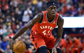 TORONTO, ON - DECEMBER 14:  Pascal Siakam #43 of the Toronto Raptors dribbles the ball during the first half of an NBA game against the Brooklyn Nets at Scotiabank Arena on December 14, 2019 in Toronto, Canada.  NOTE TO USER: User expressly acknowledges and agrees that, by downloading and or using this photograph, User is consenting to the terms and conditions of the Getty Images License Agreement.  (Photo by Vaughn Ridley/Getty Images)