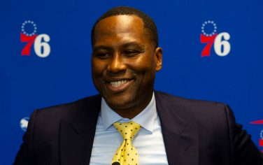 CAMDEN, NJ - SEPTEMBER 13: General Manager Elton Brand of the Philadelphia 76ers speaks at the podium prior to the team unveiling a sculpture to honor Charles Barkley at their practice facility on September 13, 2019 in Camden, New Jersey. (Photo by Mitchell Leff/Getty Images) *** Local Caption *** Elton Brand