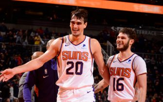 PHOENIX, AZ - NOVEMBER 21: Dario Saric #20 and Tyler Johnson #16 of the Phoenix Suns smile during the game against the New Orleans Pelicans on November 21, 2019 at Talking Stick Resort Arena in Phoenix, Arizona. NOTE TO USER: User expressly acknowledges and agrees that, by downloading and or using this photograph, user is consenting to the terms and conditions of the Getty Images License Agreement. Mandatory Copyright Notice: Copyright 2019 NBAE (Photo by Barry Gossage/NBAE via Getty Images)